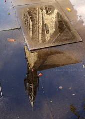 St Vincent de Paul Reflection (2011) (.annajane) Tags: uk england reflection church water liverpool puddle pavement spire sidewalk parklane stvincentdepaul merseyside pavingstones