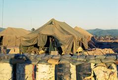 Vietnam 1969 - Photo by Bernie - FAC tent home behind sand in barrels, bags and barb wire. Kontum (manhhai) Tags: photostream