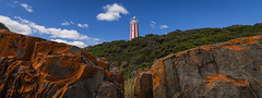 Mersey Bluff Lighthouse (lights+shades) Tags: blue red sky cloud lighthouse white green coast rocks australia shore tasmania tas devonport merseyblufflighthouse