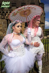 IMG_9305 (Neil Keogh Photography) Tags: pink flowers blue white green abbey graveyard yellow dreadlocks female umbrella fence shoes purple candy boots lace bra gothic goth goggles trainers tattoos gloves corset braids spikes gravestones tutu choker cybergoth whitbyabbey dogcollar fishnettights whitbygothweekend fishnettop april2016