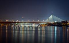 Color of the night (radomir_bojic) Tags: city bridge blue light night reflections river landscape ada long exposure darkness serbia most belgrade beograd noc sava reka refleksije