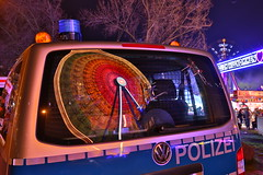 Big wheel in the mirror (Mettwoosch) Tags: auto city longexposure travel lightpainting tree window car night canon reflections germany lens deutschland lights mirror licht town cityscape fairground nacht fenster spiegel cologne police kln citylights stadt l bigwheel spiegelung polizei koeln baum ef kirmes riesenrad lichter langzeitbelichtung volksfest reflektionen scheibe 5dm3