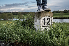 Borderline (ah_photographix) Tags: blue sun green grass stone germany shoe windy sneakers converse chucks