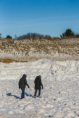 People Crossing Field of Ice Balls Created During Winter Storms in Rosy Mound Natural Area along Lake Michigan (Lee Rentz) Tags: park winter wild usa snow cold ice beach nature water america season walking outdoors coast frozen dangerous midwest waves unitedstates natural hiking snowy michigan dunes seasonal freezing lakemichigan trail shore northamerica hikers icy storms spheres slippery hazard sanddunes spherical ridges wintery wintry midwestern iceballs rosymoundnaturalarea iceboulders leerentzcom ottawacountypark