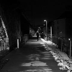 a long way to run (maekke) Tags: street winter urban snow man architecture night dark square switzerland availablelight streetphotography 11 fujifilm zrich ch kreis5 2016 viadukt x100t