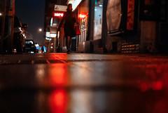 tightrope (ewitsoe) Tags: street windows winter urban streets cold metal night 35mm walking lights neon day cityscape walk polska pedestrian sidewalk poznan wetpavement poalnd nikond80 ewitsoe