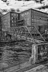 Saco Island Walkway (jpr_me) Tags: bridge mill river industrial maine newengland walkway d100 saco biddeford sacoriver pedestrianwalkway millbuilding factoryisland westpointpepperell sacoisland newenglandmill 1855gnikkor 1855nikkorg