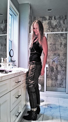 Get Serious (lost.mohican) Tags: woman black sexy smile leather hair bathroom mirror belt eyes breasts long tank arms boots muscular top hips blonde trousers strong tall harness tousled gaze tough wavy straps buckles direct loose enigmatic challenging slender crossed lean lowslung