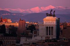Roman sunset (luigig75) Tags: winter sunset italy mountain snow rome roma skyline montagne italia tramonto cityscape monte vittoriano velino sirente 450d tamronsp70300mmf456divcusd