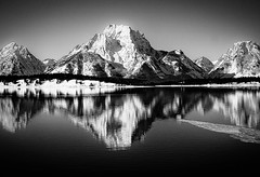 The Tetons (Dennis Herzog) Tags: park winter snow mountains cold reflection water monochrome reflections parks wyoming mountmoran tetons nationalparks americanwest grandtetonnationalpark jacksonlake blackandwhilte
