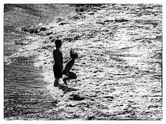 Jump ! (kurtwolf303) Tags: ocean sea people bw espaa topf25 strand spain topf50 topf75 meer 500v20f kanaren shore tenerife sw ufer teneriffa topf100 canaryislands spanien 800views omd digitalphotography islascanarias 900views 750views 1000v40f 250v10f monochromefineart systemcamera unlimitedphotos micro43 microfourthirds olympusem1 kurtwolf303