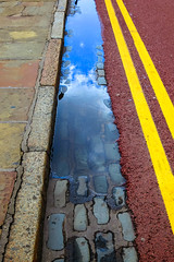 BRY_20150707_IMG_7044_ (stephenbryan825) Tags: blue sky cloud reflection lines yellow contrast liverpool puddle grey purple graphic vivid wideangle simplicity gutter abstracts cobbles kerb minimalist albertdock yellowlines cameraeffect persective selects strongcolour uncluttered wideangledistortion simplecomposition boldshapes tightlycomposed