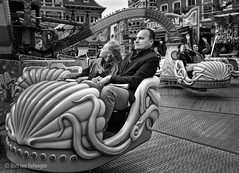 Having Fun (Is he really?) (Bart van Hofwegen) Tags: street haarlem fun amusement ride fairground father roundabout daughter fair entertainment octopus amusementpark merrygoround funfair attraction fairattraction