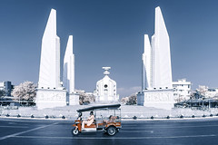 Democracy Monument -  (huwpenson) Tags: street city blue red urban white tourism monument landscape ir thailand democracy asia ride spectrum bangkok pillar landmark thai infrared tuktuk nm infra tuk soe bkk 665  665nm