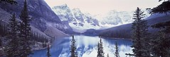 Valley of Mountains (rubberducky_me) Tags: blue trees panorama mountain lake snow canada reflection film ice fog america forest velvia alberta northamerica banff linhof morainelake linhoftechnorama valleyoftwelvepeaks