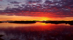 Fiery Sunset (maya the viking_girl) Tags: sunset red sea sky sun seascape reflection beach nature water norway clouds landscape colorful outdoor tjme