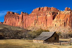 The Historic Fruita Barn at Capitol Reef National Park (Dave Toussaint (www.photographersnature.com)) Tags: wood travel november autumn usa history fall nature barn photoshop canon landscape utah photo interestingness google interesting ut raw day photographer image scenic picture clarity historic explore cc adobe getty redrock fruita adjust waynecounty 2015 highway24 denoise 60d topazlabs giffordhomestead photographersnaturecom davetoussaint creativecloud fruitabarn capitolreefnationapark