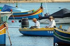 pescatori - fishermen (immaginaitalia) Tags: sea colors island boat mediterraneo barca mare fishermen south traditional malta colori sud marsa isola scirocco tradizionale marsaxlokk mediterraneum pescatori
