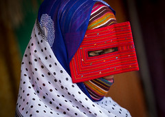 a bandari woman wearing a traditional mask called the burqa at panjshambe bazar thursday market, Hormozgan, Minab, Iran (Eric Lafforgue) Tags: red people woman face horizontal outdoors persian clothing asia veil mask iran market muslim islam religion hijab culture persia headshot hidden covered iranian bazaar adults adultsonly oneperson islamic traditionaldress burqa customs ethnicity middleeastern sunni burka chador 20sadult youngadultwoman balouch hormozgan onewomanonly burqua  bandari  embroidering 1people  iro thursdaymarket  minab unrecognizableperson colourpicture  borqe panjshambe panjshambebazar boregheh iran034i2728