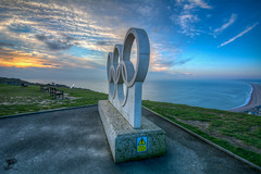 ''The Rings'' (marcbryans) Tags: ocean seascape beach monument skyline clouds bench outdoors coast horizon sunsets wideangle olympic chesil portlanddorset tokina1116mm nikond7100