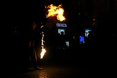 A female street performer spits fire in the streets of Rome, Italy (allisonrubin) Tags: italy rome fire streetperformer romeitaly spittingfire