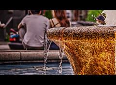 4C (Paul B0udreau) Tags: toronto water fountain girl nikon couple distillerydistrict dof traffic danforth bicyclist distillery summerevening steeringwheel greektown 4c nikkor1855mm streetcapture