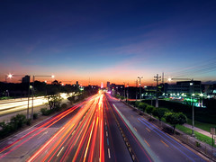 sunset exposure.. (hailin.elle) Tags: road street city longexposure blue sunset sky cloud building cars skyline lights twilight highway colorful cityscape outdoor dusk streetlights bluesky structure citylights infrastructure vehicle canonphotography