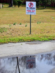 No Parking Sign. (dccradio) Tags: reflection grass sign outdoors nc pavement lawn northcarolina reflected greenery signpost blacktop lumberton noparkingsign towedaway unauthorizedvehicles robesoncounty ownersexpense walnutmanorapartmentsoutside
