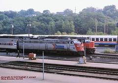 , Rensselaer, NY.   9-12-1976 (jackdk) Tags: railroad train railway amtrak albany locomotive frisco e9 e8 ln roster albanyrensselaer slsf louisvilleandnashville sdp40f emde9 emde8 locomotiveroster rensselaerstation