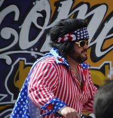 Flag dressed Elvis - Krewe of the Rolling Elvi (Monceau) Tags: colorful parade mardigras kreweofiris