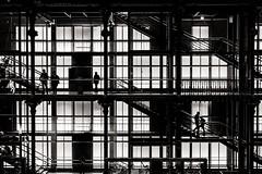Stuck on the grid (glancan) Tags: people blackandwhite bw paris monochrome silhouette architecture blackwhite noir fuji noiretblanc geometry pic nb contraste fujifilm blanc bâtiment escalier lignes noirblanc galeriedelévolution xt10 xf1855