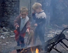 Safe play (theirhistory) Tags: uk boy england cinema film fire kid shoes child burning jacket trousers wellingtonboots wellies newsreel