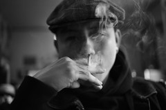 Chng Baber Shop (Gorgeous Harrison) Tags: portrait blackandwhite bw guy smoke fineart feel hipster indoor tattoos lightandshadow babershop 35mmf20 hipsterfashion canon6d hipsterguys tattoosguy