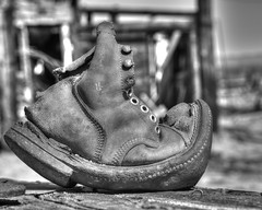 Shoe (magnetic_red) Tags: wood old blackandwhite texture leather boot shoe focus depthoffield bent sole wornout stiches