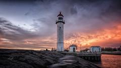 Sky on Fire... (Lefers.) Tags: sunset sky lighthouse netherlands rain fire zonsondergang rotterdam fuji nederland dramatic filter lucht drama hellevoetsluis fujinon vuurtoren hitech regen formatt xt1 1024mm