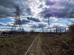 Black Country Skies (Jason_Hood) Tags: disused abandoned railway railroad southstaffordshireline southstaffordshirerailway pylon pylons hightensiontower electricitypylon transmissiontower