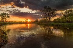 Springtime in the river valley (piotrekfil) Tags: sunset sky sun tree nature water clouds wow reflections river landscape spring pentax poland piotrfil