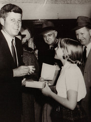 JFK Signs Autograph for Young Girl