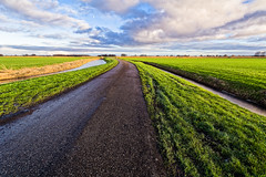 The Long Run (Alfred Grupstra Photography) Tags: road sky green grass clouds landscape nikon pastures