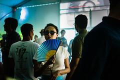 Fan Dance. (Presence Inc) Tags: street light portrait people urban stilllife colour festival night 35mm dark photography dance still singapore mood candid sony performance streetphotography nightlife cinematic society crowds nightpeople mirrorless rx1r rx1rm2