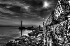 Fishing next to the lighthouse (theseustroizinian) Tags: sea bw seascape monochrome canon landscape seaside hellas greece hdr loutraki canoneos700d eos700d