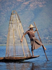 Fisher of Men (Feldore) Tags: lake net water boat fishing fisherman burma traditional olympus cage panasonic rowing myanmar inle burmese mchugh conical rower em1 onelegged 35100mm feldore