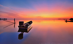 Reflection of Single Boat with Rays Sky During Sunrise/Sunset (azimuddin_ibrahim) Tags: ocean morning travel blue sunset red sea summer wallpaper sky panorama cloud sun seascape reflection beach nature water beautiful beauty sunrise vintage river landscape dawn evening boat wooden twilight fishing asia alone ray ship natural outdoor background traditional scenic peaceful scene panoramic oldschool transportation malaysia boating scape tranquil malay