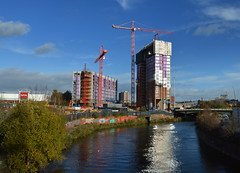 New build in Manchester (Tony Worrall Foto) Tags: county new city uk blue homes england sky reflection building wet water architecture modern river manchester flow outdoors design stream tour shine open place riverside northwest unitedkingdom country north sunny visit location flats area highrise blocks tall sunlit build northern update salford attraction buildingblocks manc gmr newish welovethenorth