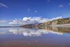 Clouds building from afar (pauldunn52) Tags: sea seascape heritage beach wet wales clouds reflections temple bay coast sand cliffs glamorgan