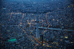 Skytree Blue Hour Aerial (Sandro Bisaro) Tags: city urban building tower japan skyline skyscraper canon buildings lights tokyo lowlight asia cityscape view skyscrapers aerialview aerial helicopter  nippon  bluehour japon giappone nihon tokio megacity skytree elevatedview  tokyoskytree canon5dmarkiii canon2470mmf28liiusm sandrobisaro