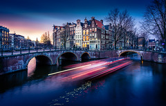 Lightspeed (miguel_lorente) Tags: street city longexposure trees houses light sunset sky holland reflection netherlands amsterdam night boat movement cityscape bridges canals prinsengracht