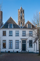 View to Utrecht's Domtoren from Pieterskerkhof (natures-pencil) Tags: utrecht domtoren bluesky courtyard stucco housefront cathedraltower lovelycity pietyerskerkhof