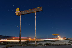 midnight rider. yucca, az. 2015. (eyetwist) Tags: road longexposure arizona usa moon southwest west tree abandoned sign night america vintage dark stars typography route66 nikon ruins long exposure desert diesel wind trucker transport mother rusty motel roadtrip 66 gone gas gasstation fullmoon truckstop route american mojave type americana moonlight trucks lonely streams interstate 40 roadside gasoline nikkor bros yucca fuel trucking taillights whiting i40 startrails mojavedesert kingman typographic bulldozed urbex vanished eyetwist whitingbros 1024mm d7000 eyetwistkevinballuff 1024mmf3545g americantypologies