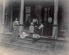 Family gathered on the front porch (simpleinsomnia) Tags: old family white man black monochrome vintage found blackwhite kid chair child antique snapshot front photograph porch vernacular rocking rockingchair frontporch foundphotograph